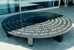 Social Security Seating, 1999, I.R.S. computer facility, 10' diam, black granite - image courtesy of Francoise Yohalem